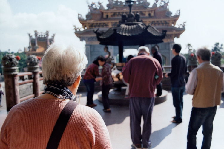 Taiwanese Culture Taiwanese Temple Film Is Not Dead Film 35mm Film Analogue Photography People Watching Potrait Politics And Government Warm Clothing Rear View History Cultures Sky Architecture Place Of Worship Religion Spirituality Temple - Building Pew Temple The Photojournalist - 2018 EyeEm Awards A New Beginning