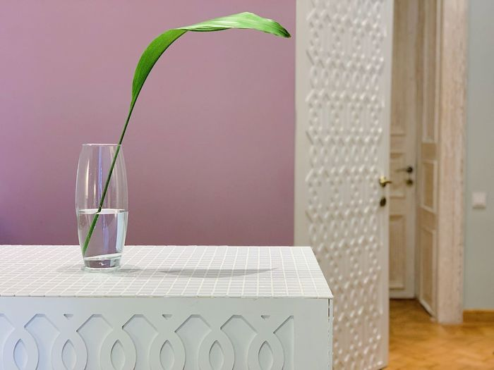 Glass vase on table at home
