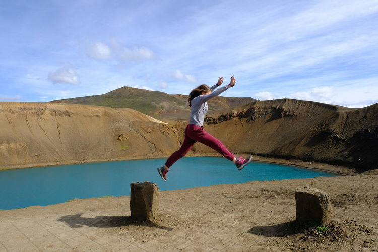 Volcano Crater Volcano Landscape Beauty In Nature Energetic Jumping Leisure Activity Lifestyles Mid-air Motion Nature One Person Outdoors People Real People Sky Water Young Adult Young Women