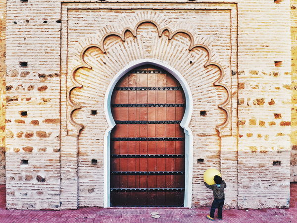 Door Entrance Day Architecture Doorway Built Structure Building Exterior Outdoors Real People People Adult One Person Adults Only Only Men Playing Playing Child Childhood Children Playing Mosque Islamic Architecture Marrakech Innocence Morocco Morocco 🇲🇦 The Secret Spaces Lost In The Landscape
