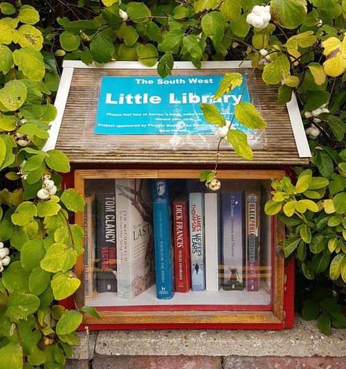 This small library cabinet is on a wall in Dorset, England. People are encouraged to take books and donate those they have read. Hedge Library Roadside Library Books Borrow And Donate Books Tom Clancy Dick Francis P D James James Thompson David Wishart Andrew Martin Lynn MacDonald Popular Authors Book Lovers Dorset Uk England Samsung Galaxy S7 EyeEmNewHere
