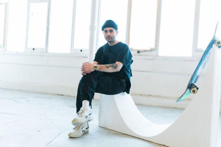 Portrait of man sitting on sport ramp