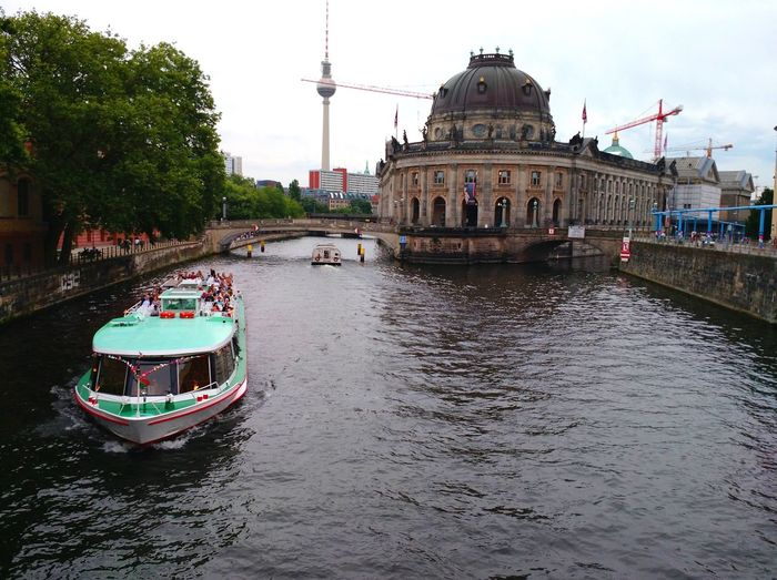 Berlin, Germany - July 8 2016: A river cruise on river Spree, with Bode Museum in the background Berlin Germany Europe Boat Cruise Trip River Spree Museum Bode Museum Museum Island Water Fun Tourists Tourism Travel Exploring Bridge Culture Transportation Vessel Nautical Vessel Aerial View People