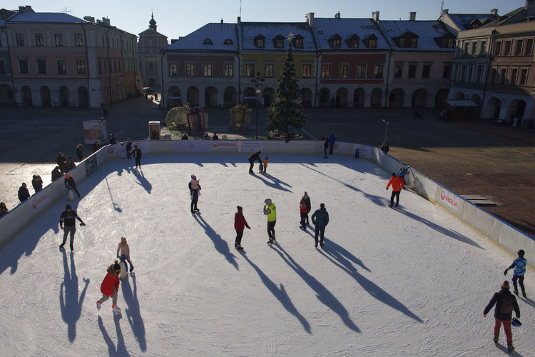 High angle view of people in town square during winter