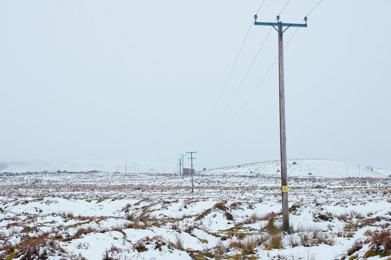 Power lines on Dartmoor in winter Dartmoor Beauty In Nature Cable Clear Sky Cold Temperature Connection Day Field Frozen Landscape Nature No People Outdoors Pylons Scenics Sky Snow Technology Tranquil Scene Tranquility Weather White Color Wilderness Winter