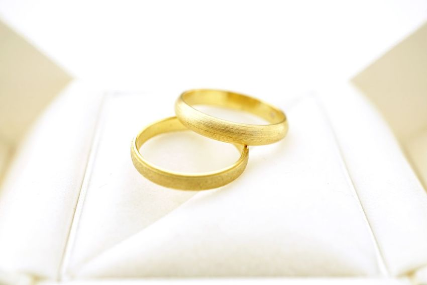 Gold wedding rings in ring box Wedding Background White Copy Space Wedding Ring Box Close Up Nobody Gold Jewelry Rings Wedding Invitation Wedding Rings Wedding Rungs Celebration Ring Gold Colored Jewelry Wedding Gold Wedding Ring Love Event Two Objects Life Events No People Still Life Close-up Luxury
