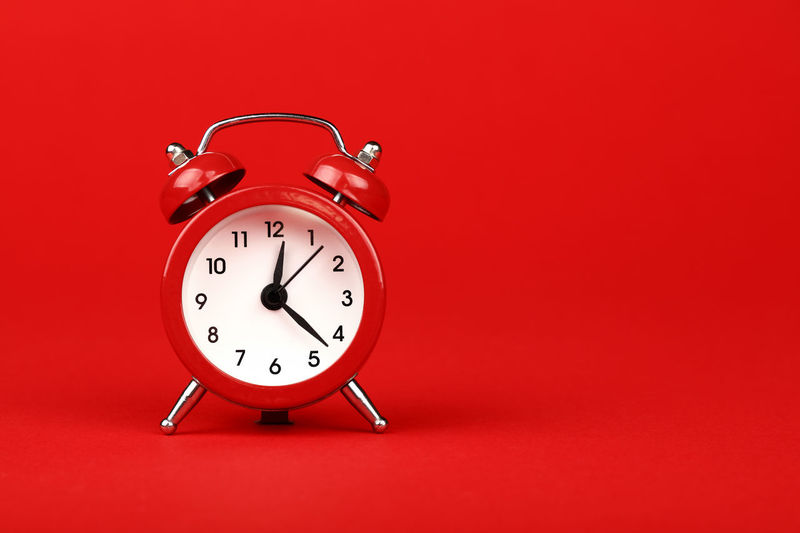 Close up retro styled alarm clock over red background with copy space Retro Styled No People Single Object Clock Time Alarm Clock Red Studio Shot Copy Space Colored Background Red Background Front View Full Length Metal Waking Up Checking The Time Urgency Clock Face Minute Hand Deadline Vivid Vivid Colours  Color Signal Warning Timing Still Life