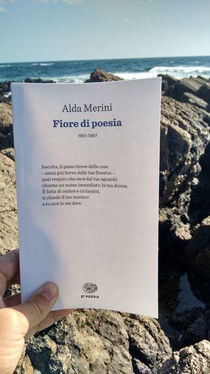 Text Western Script Water Sea Travel Destinations Personal Perspective Holding Non-urban Scene Outdoors Tourism Vacations Sky Journey Tranquil Scene Alda Merini Alghero, Sardinia, Italy Poesia