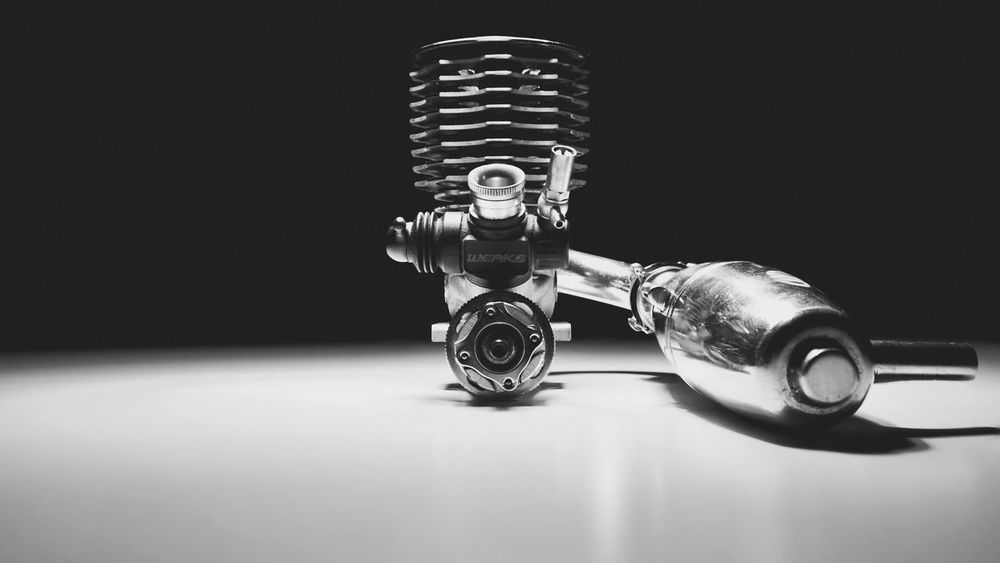 Machine, a strange sounding word, imbibes power and purpose by man. Extreme Sports Car Racing Product Illuminated RC Engine Vscocam Product Photography VSCO Commercial Photography Close-up Commercial EyeEm Best Shots Black Background Nitro Studio Shot The Week On Eyem Welcomeweekly