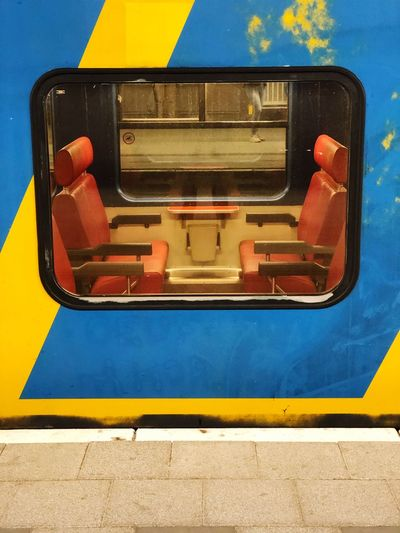 Dutch intercity train window Holland Dutch Ns Empty Train Empty Carriage Looking In Peeling Paint First Class Commuting Window Train EyeEm Selects Yellow Blue No People High Angle View Communication Day Transportation Mode Of Transportation Multi Colored