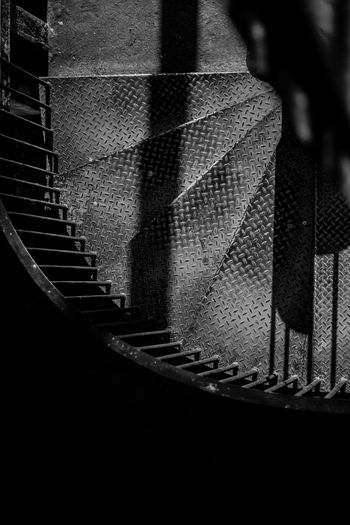 Camera - Canon 550D - Lens - 50 mm f/1.8 Blog : https://www.instagram.com/david_sarkisov_photography/ Staircase Steps And Staircases One Person Indoors  Architecture Railing Close-up Built Structure Pattern Human Body Part Spiral Moving Up Dark Body Part Metal Night Building Human Limb Architecture Blackandwhite Black And White My Best Photo Streetwise Photography