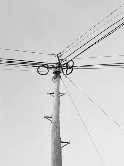 The electric wires Electricity Pylon Power Supply No People Day Sky Copy Space Backgrounds Negative Space Electric Wire Wooden Post Wires And Sky Wires And Cables Wires Up The Sky Electricity  Power Line  Connection Monochrome Photography Monochrome Black And White Photography Power Line  Technology Electricity  Cable Modern EyeEmNewHere