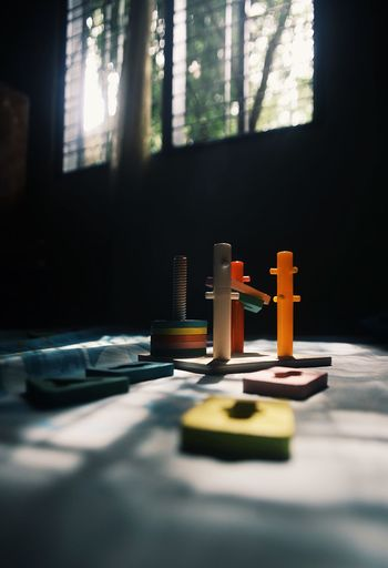 Close-up of toy on table by window