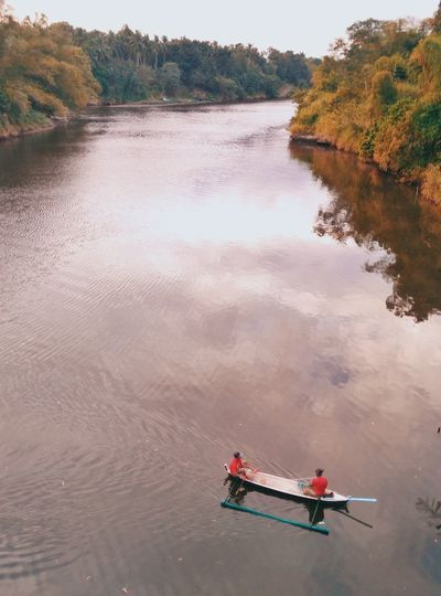 High Angle View Of Rowers In River