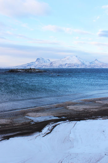 Winterbeach in Bodø Sky Beauty In Nature Tranquil Scene Scenics - Nature Water Tranquility Winter Cold Temperature Snow Mountain Nature Cloud - Sky Non-urban Scene No People Day Sea Environment Idyllic Outdoors Snowcapped Mountain Mountain Peak Ice Bodø Norway Winterbeach