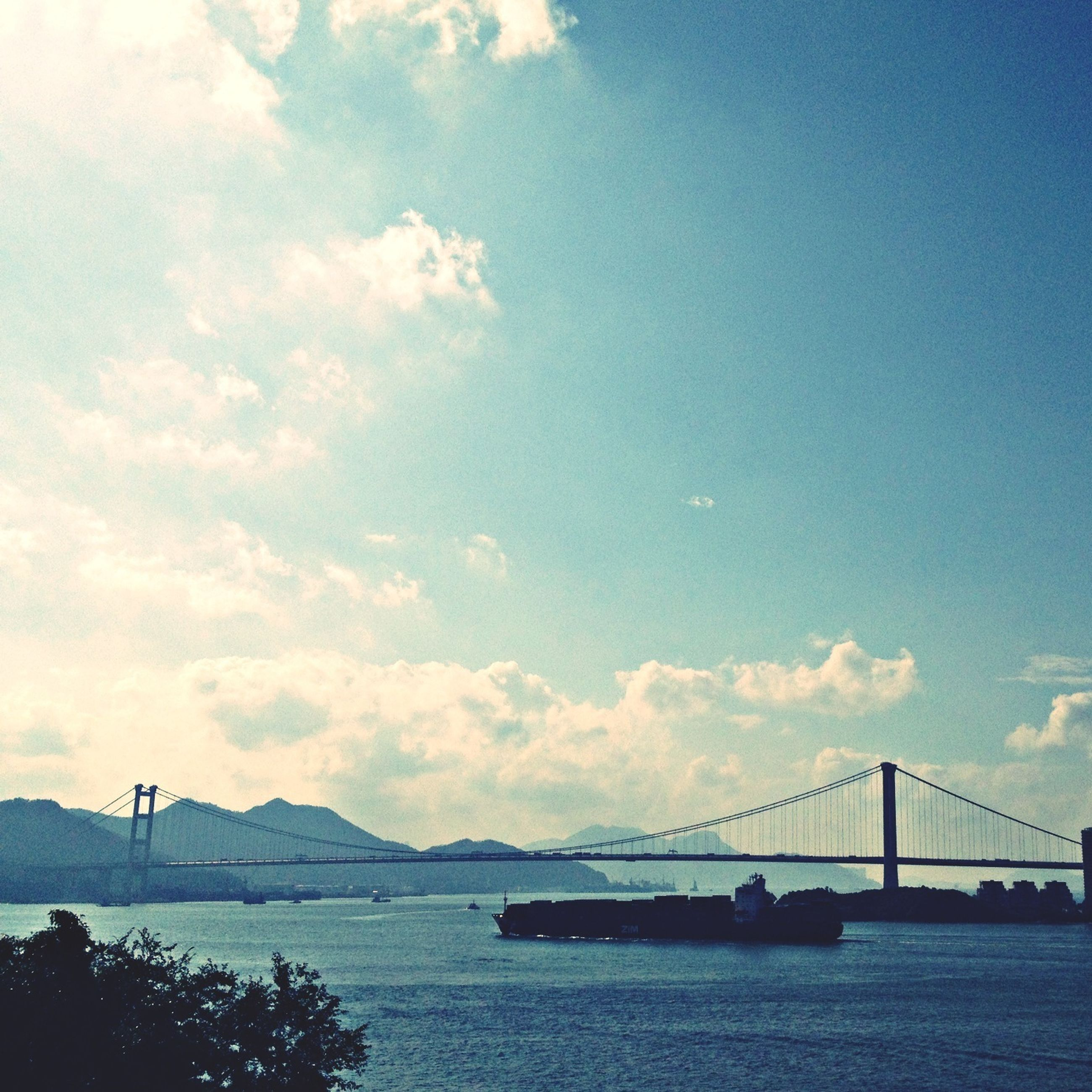 connection, bridge - man made structure, sky, water, built structure, architecture, suspension bridge, engineering, waterfront, transportation, bridge, river, cloud - sky, sea, cloud, tranquility, mountain, tranquil scene, scenics, nature