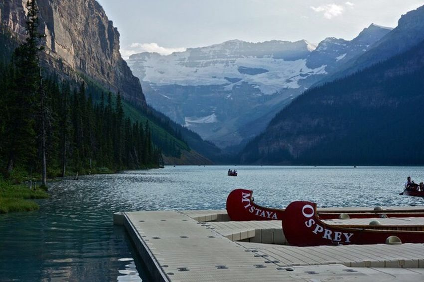The Essence Of Summer Banff  Banff National Park  Alberta Canoe Alpine Getoutside Canada Mistaya River Lake Louise,Alberta Lake Louise  Lake Mountain Mountains Rockies Rocky Mountains Evening Sun Ray Osprey  Mountain Lake North America