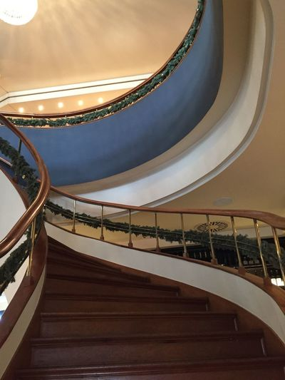 Low Angle View Of Steps With Decorated Railings In Building
