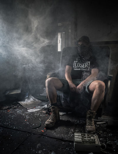 Man sitting in abandoned room