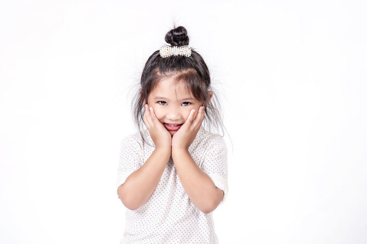 Portrait of a smiling girl over white background