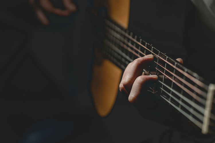 Music Musical Instrument String Instrument Guitar Playing Arts Culture And Entertainment Musical Equipment Human Hand Musician Musical Instrument String String Artist Hand One Person Human Body Part Plucking An Instrument Selective Focus Indoors  Skill  Guitarist Acoustic Guitar Finger Electric Guitar Rock Music