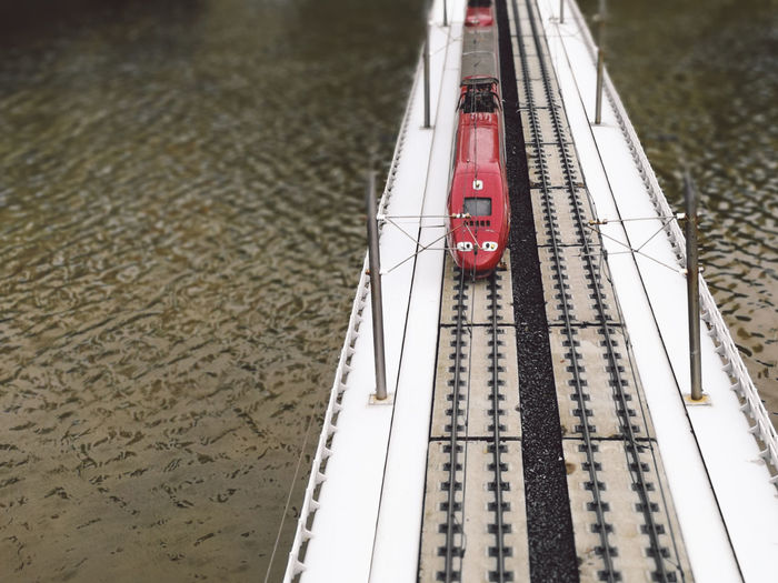 High Angle View Of On Train On Bridge Over River