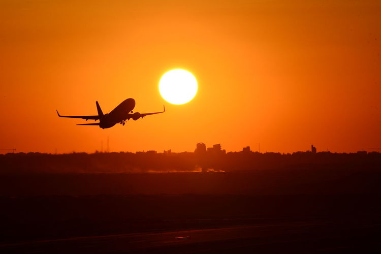 Air Vehicle Airborne Airplane Airport Beauty In Nature Flying Flymetothesun Intothesun Journey Mid-air Mode Of Transportation Motion Nature No People on the move Orange Color Outdoors Scenics - Nature Silhouette Sky Sun Sunlight Sunset Transportation Travel