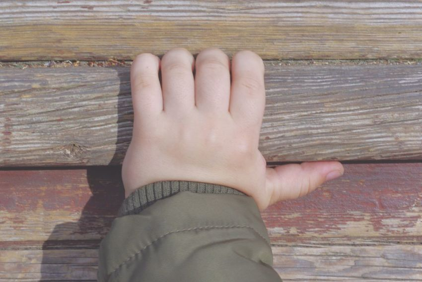 Hand of a child holding to a wooden ladder Real People Human Hand Wood - Material Human Body Part One Person Day Close-up Outdoors People Boy Child Girl Childhood Playground Ladder Future Education Learning Holding Holding To Grabbing Hand Cute