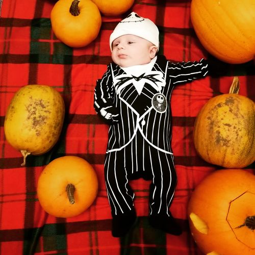 Full length of a boy with pumpkins