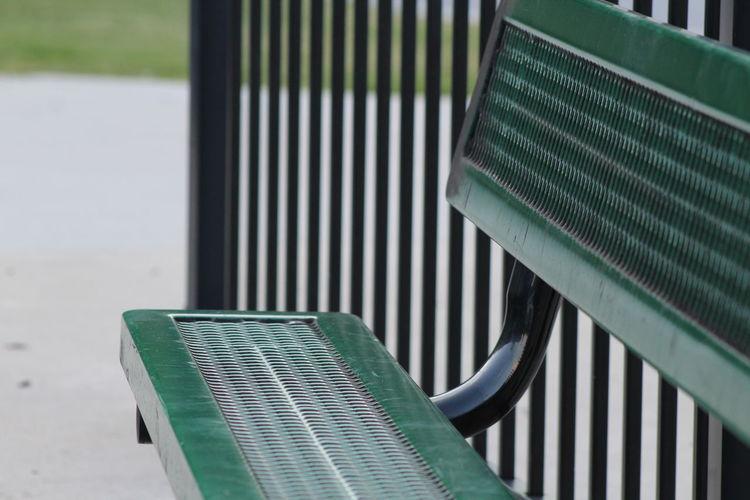 Green Metallic Bench By Railing