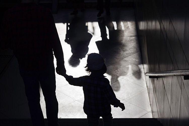 Silhouette People Standing In Corridor