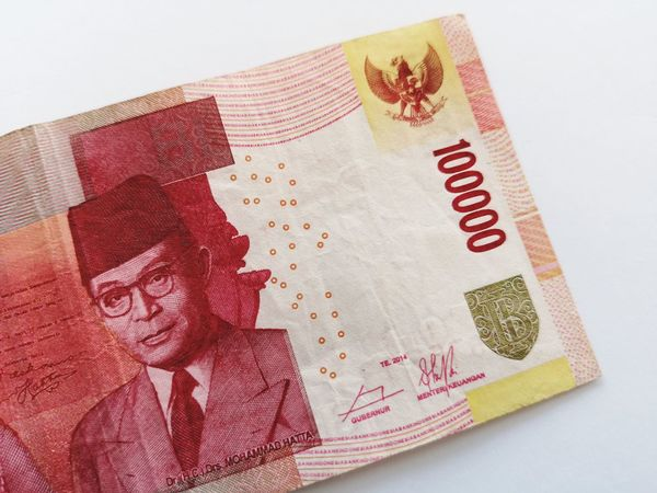 Indonesia currency over white background INDONESIA Paper Currency 100000 Rupiah Color Background Attraction White Background EyeEm Selects Crumpled Paper Coin Currency Studio Shot White Background Paper Currency Arts Culture And Entertainment Exoticism Wealth Red Bank Loan  Tax Investment Currency Symbol Money Savings Signature Financial Advisor Banking