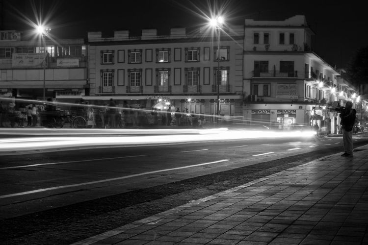 Architecture Blurred Motion Building Exterior Built Structure City City Life City Street Illuminated Incidental People Light Trail Lighting Equipment Long Exposure Monochrome Motion Night Night Lights Nightphotography Outdoors Photography In Motion Road Speed Street Street Light Streetphoto_bw Transportation