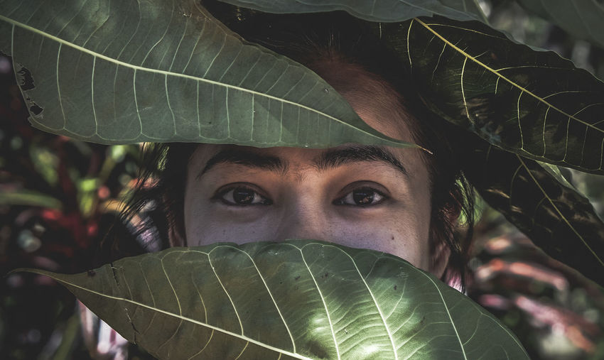 EyeEm Best Shots Close-up Day Eye Freshness Green Color Growth Headshot Leaf Lifestyles Looking At Camera Nature One Person Outdoors Plant Portrait Real People Tree Young Adult Young Women