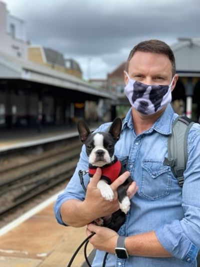 Portrait of man with dog on train