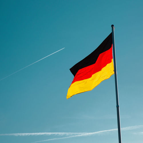Sky Flag Low Angle View Patriotism No People Day Blue Vapor Trail Wind Environment Outdoors Copy Space Red Pole Yellow Emotion German Flag Germany🇩🇪 Flying Progress Blue Sky Positive Proud National Flag Colorful