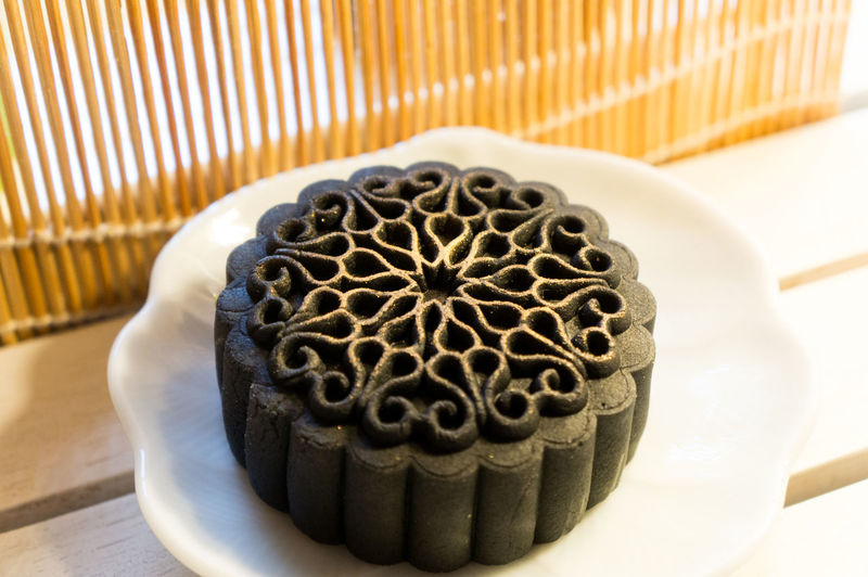 Mid-Autumn Festival moon cake on wooden board Asian  Asian Culture Cuisine Moon Cake Time MooncakeFestival Baked Bakery Fullmoon Mid Autumn Festival Mooncake Sweet Sweet Food Traditional Wooden Board