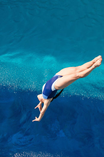 High angle view of woman jumping in swimming pool