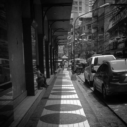 05/29/2016 Escolta  Sidewalk Pavement Pattern Circle Shadow Lightandshadow Bnw Bw Bnw_captures Bnwphotography Bnwmood Bw_photooftheday Bwphotography Bwphoto Bw_shotz Www_streetshots Www_photography Philihappy