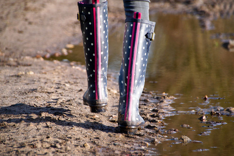 Dotted Gumboots Muddy Waters Puddleography Wellies  Wellington  Close-up Day Dots Low Section Mud Muddy Nature No People Outdoors Points Puddle Puddle Reflections Rubber Boots Scored Walking Water Wet