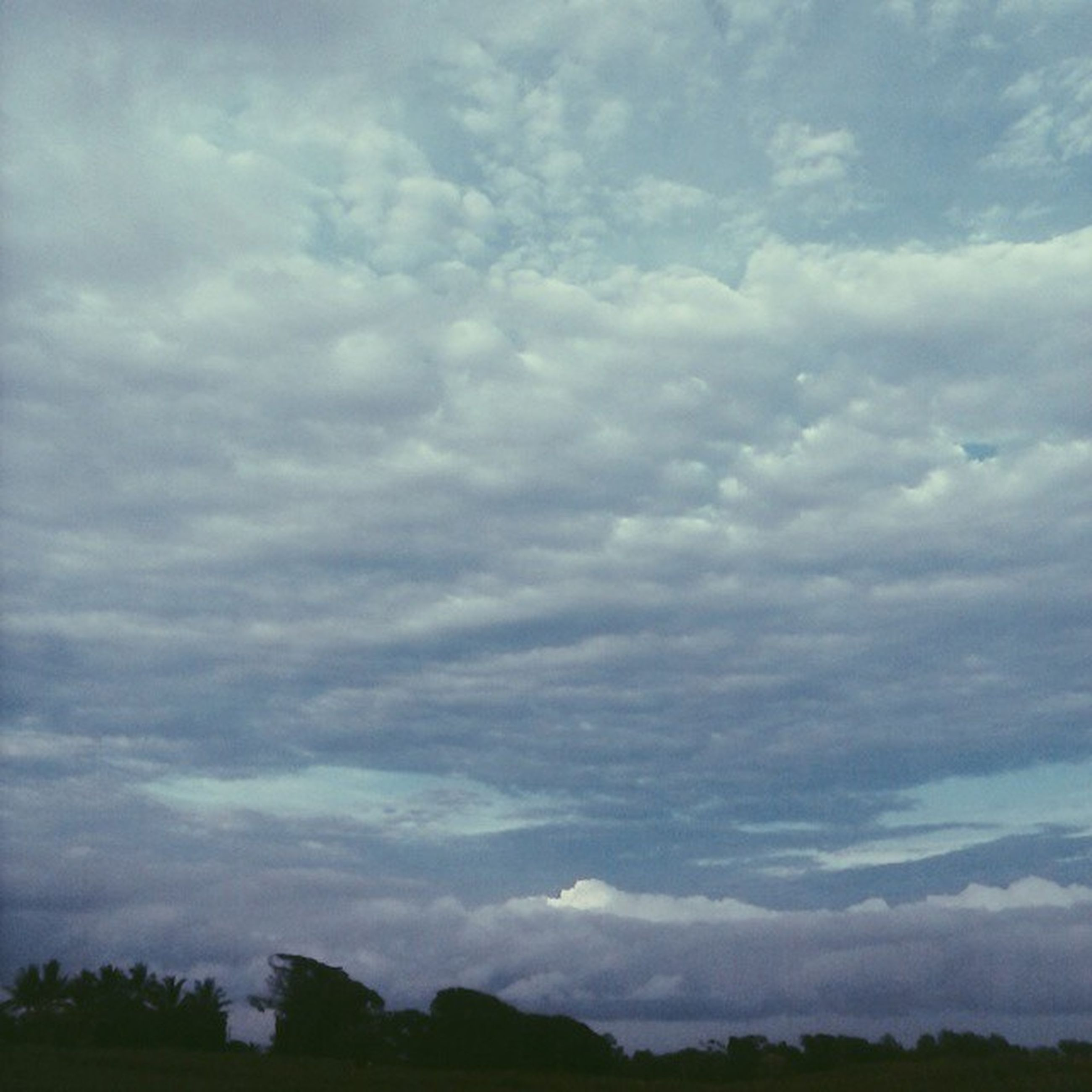 sky, cloud - sky, cloudy, tranquil scene, tranquility, scenics, beauty in nature, landscape, nature, cloud, tree, weather, cloudscape, overcast, idyllic, silhouette, non-urban scene, outdoors, mountain, low angle view