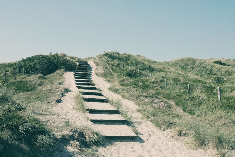 Staircase On Hill At Beach Against Clear Sky