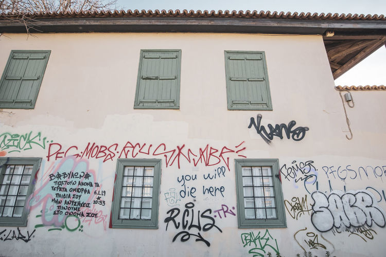Athens Athens Greece Athens, Greece Acropolis Architecture Building Exterior Built Structure Graffiti Communication Text Building Window No People Western Script Day Creativity Outdoors Wall - Building Feature Residential District Low Angle View Script Art And Craft Non-western Script Message