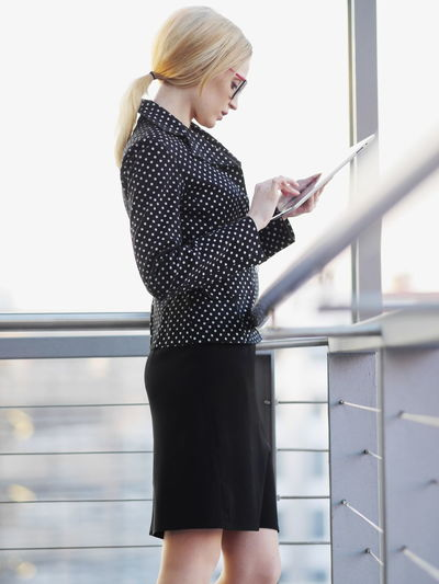 Woman Using Tablet Indoors
