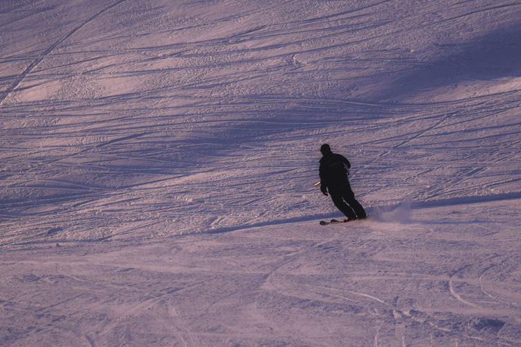Person skiing on snow covered landscape
