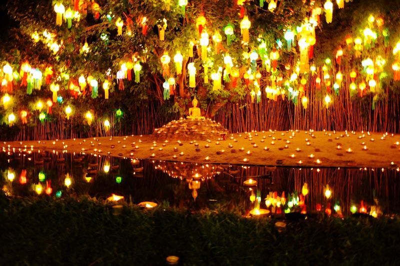 Yipeng_Lanna Loykrathong Festival Buddhist Temple Buddha Illuminated Night No People Celebration Tree Outdoors