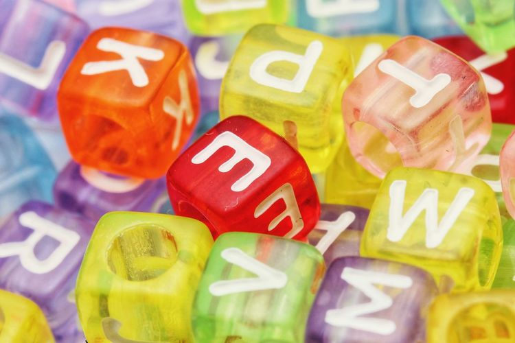 Close up alphabet beads. Beads Bright Colors and patterns Alphabet Multi Colored Backgrounds Toy Block Variation Vibrant Color Red Close-up Cube Shape Block Shape Shining Relaxed Moments
