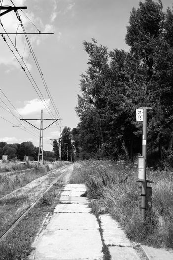 Black And White Black And White Photography Blackandwhite Diminishing Perspective Nowahuta Outdoors Poland Railroad Track Sky Tram Tram Stop