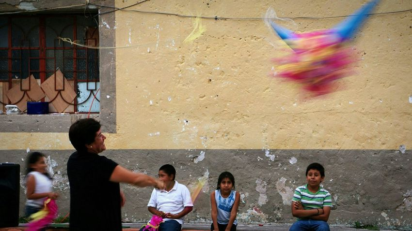 Snapshots Of Life Piñata Mom's Party Taking Photos