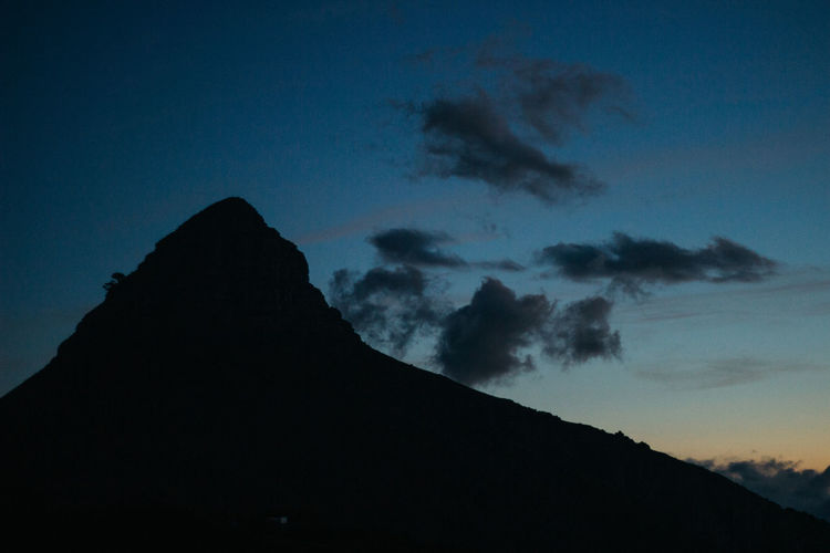 Signal Hill at Dusk. One of the most beautiful 360-degree views in the Mother City. Mid March, 2019. Sky Nature Dusk Mountain Silhouette Cloud - Sky Beauty In Nature Tranquil Scene Scenics - Nature Tranquility Low Angle View No People Mountain Peak Idyllic Environment Outdoors Non-urban Scene Night Blue Rock Jonnynichayes Cape Town South Africa Popular Photos Signal Hill Landscape Landscape_Collection Clouds And Sky Evening Beauty In Nature Beauty Minimal Minimalobsession